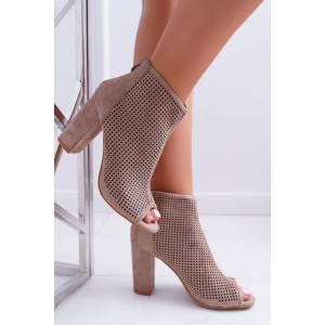 Dámské dírkované boty na hrubém podpatku v hnědé barvě