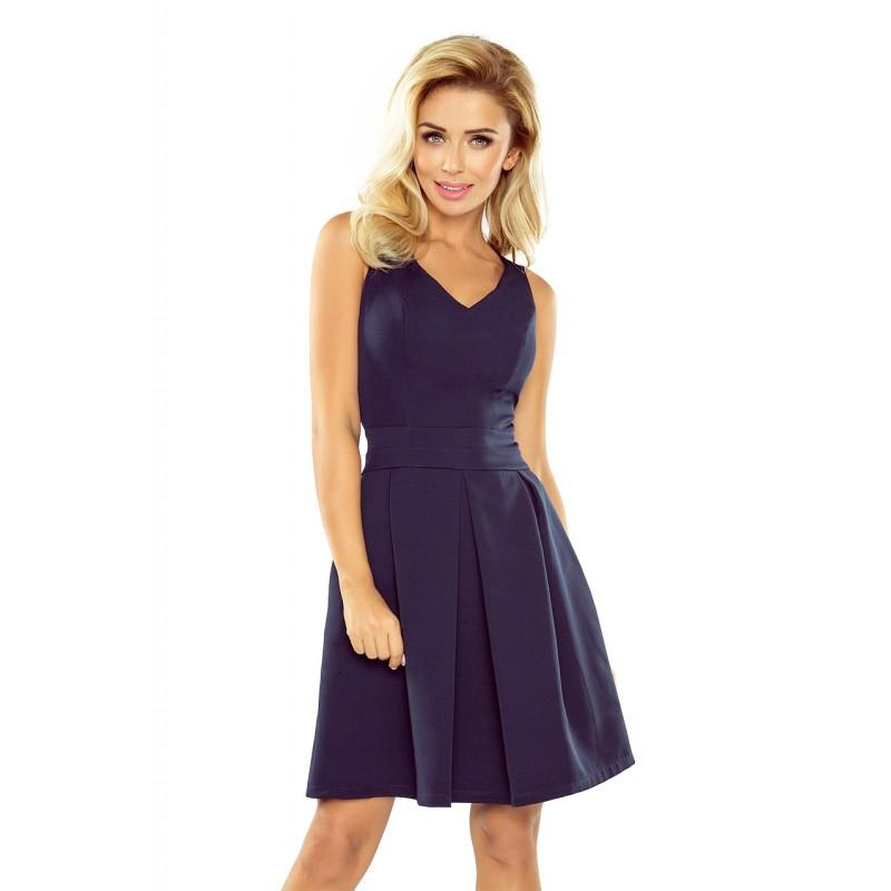 8005d5606519 Tmavě modré dámské elegantní šaty krátké s kapsami