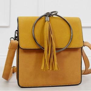 Stylová dámská kabelka v krásné žluté barvě s kovovou kulatou úchytkou