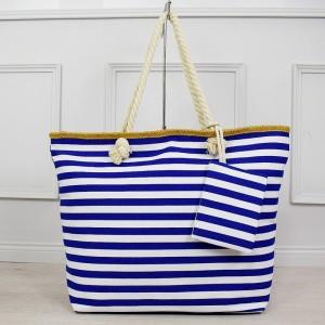 Krásná bílo modrá pruhovaná velká taška na pláž s kapsou