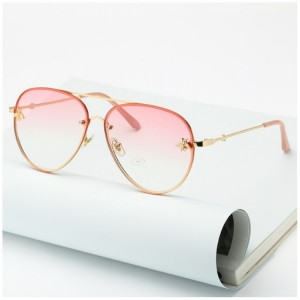 Dámské sluneční brýle růžové barvy s kovovým rámem