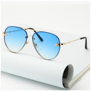 Moderní dámské sluneční brýle s modrými skly