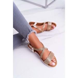 Třpytivé zlaté dámské nízké sandály se zirkony na nízké podrážce