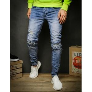 Moderní pánské džíny s dírami v modré barvě