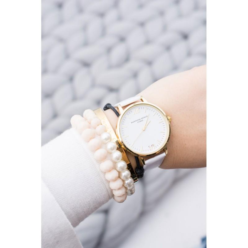 2b9999aa434 ... hodinky Elegantní bílé dámské hodinky se zlatými římskými číslicemi.  Předchozí