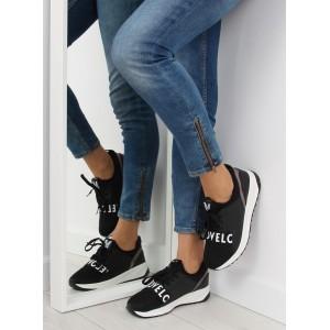 Dámské sportovní boty v černé barvě na bílé vyvýšené podrážce